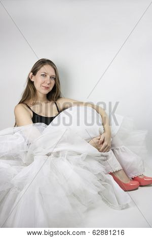 Woman wearing crinoline and shoes