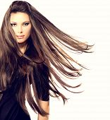 Fashion Model Girl Portrait with Long Blowing Hair. Sexy Glamour Beautiful Woman with Healthy and Beauty Brown Hair isolated on a white background. Flying long hair poster