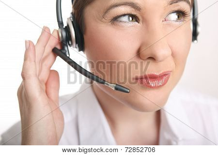 Young Woman With Headset Has Problems To Understand The Caller
