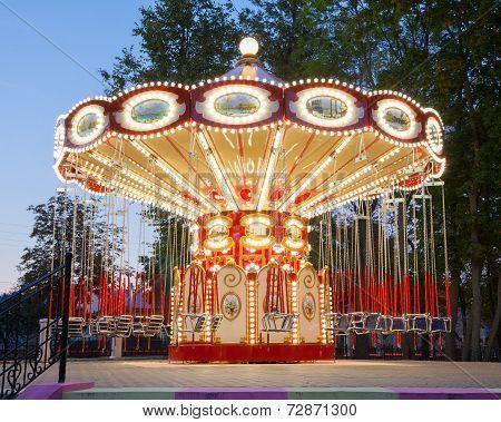 Illuminated Carousel In Park