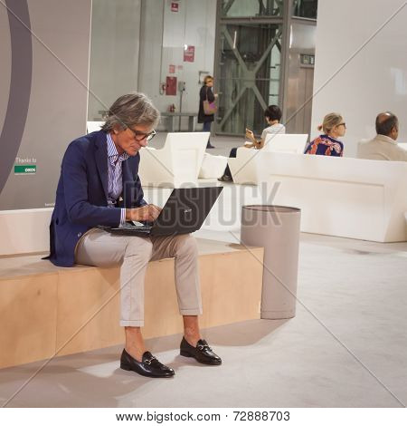 Stylish Man Working At Computer At Homi, Home International Show In Milan, Italy