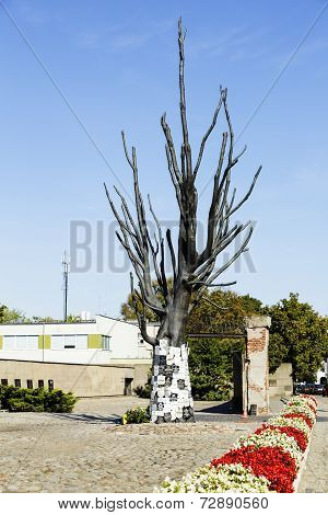 Tree Made Of Bronze With Epitaph Signs On It