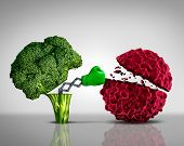 Health food and Cancer fighting foods nutrition concept with a green boxing glove emerging out of an open broccoli vegetable as a health care metaphor for a healthy lifestyle diet rich in natural fruit and vegetables to attack tumors and fight illness. poster