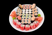 lots of sushi rolls on a big dish isolated on black clipping path poster
