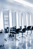 Hair salon interior. An empty chair at a hair salon poster