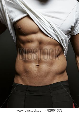 Closeup Photo Of An Athletic Guy With Perfect Abs