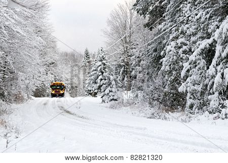 School Bus Drives On Snow Covered Rural Road