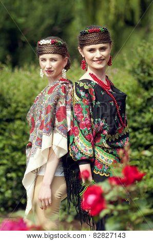 Two Caucasian Slavonic Women  In The Field Of Flowers
