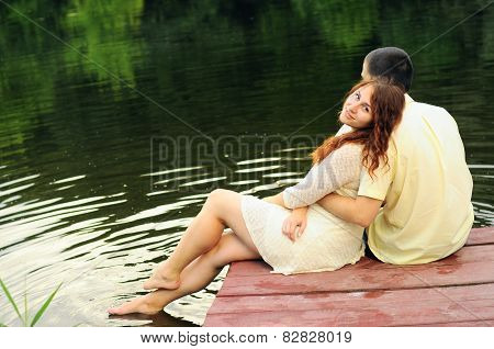 Couple Of Young Lovers  On The Pier