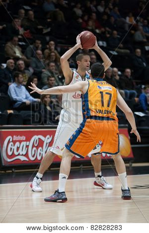 VALENCIA, SPAIN - FEBRUARY 11: 14 Martinez during Eurocup match between Valencia Basket Club and Lokomotiv Kuban Krasnodar at Fonteta Stadium on February 11, 2014 in Valencia, Spain