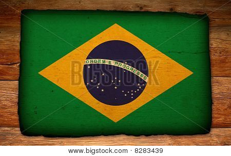 Old Brazilian Flag On Antique Wood Backdrop