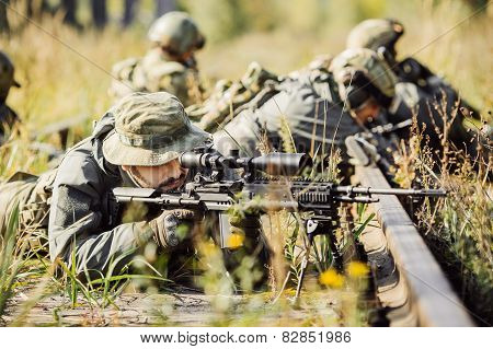 Sniper Shoot At A Target From The Sniper Rifle