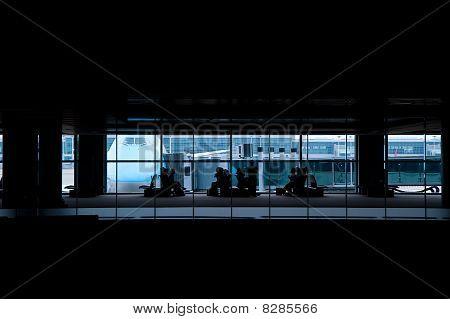 Tourist Waiting At Airport Departures Terminal