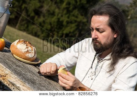long-haired man snacking healthy food in the nature poster