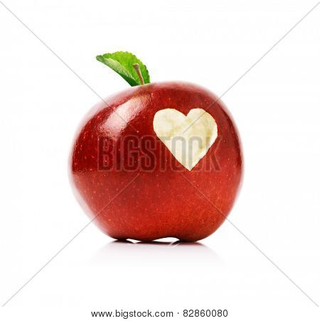 Red delicious apple with a love heart shape bitten into the flesh