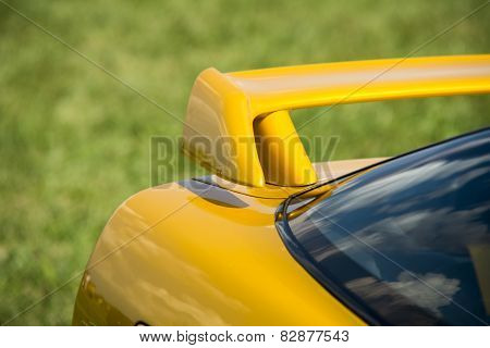 Closeup Detail Of A Custom Racing Spoiler On The Rear Of A Sports Car