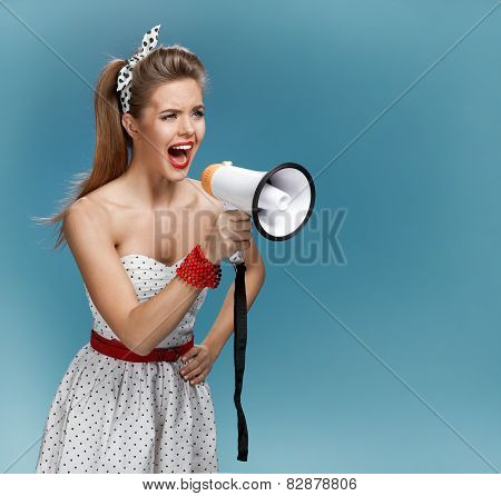 Wroth pin-up girl yells through megaphone, mouthpiece, speaking trumpet