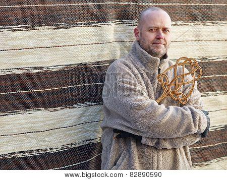 Man And Carpet Beater