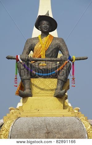Statue of the King Chao Anouvong in front of the Pha That Luang stupa in Vientiane Laos. poster