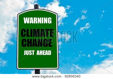 Warning Climate Change Just Ahead Written On Road Sign