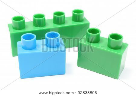 Green And Blue Building Blocks On White Background