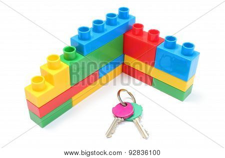 Wall Of Plastic Colorful Building Blocks With Home Keys On White Background