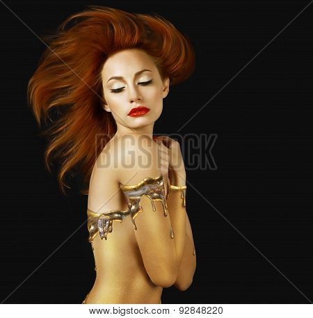 Sensuality. Red Hair Woman With Golden Skin