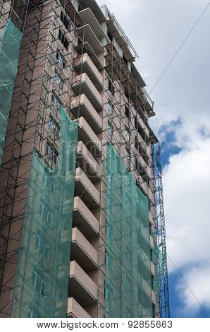 Scaffolding On The Facade Of A Tall Building