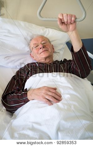 Frail Senior Man Lying In A Hospital Bed