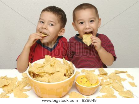 Boys Enjoying Chips