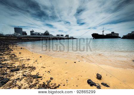 old broken ship agrounded near Lanzarote seashore, Canary Islands, Spain