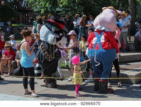 Girl Pointing At Pig Mascot