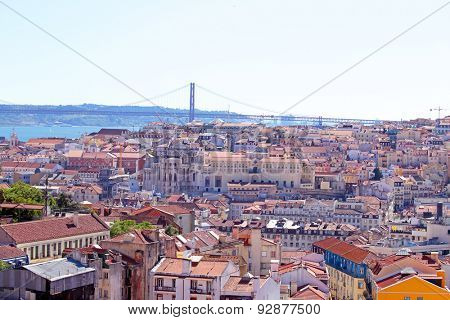 Aerial view with colored houses and the 25 abril bridge in Lisbon Portugal