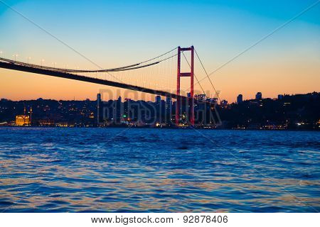 Bosporus Bridge at night with lights in Istanbul, Turkey
