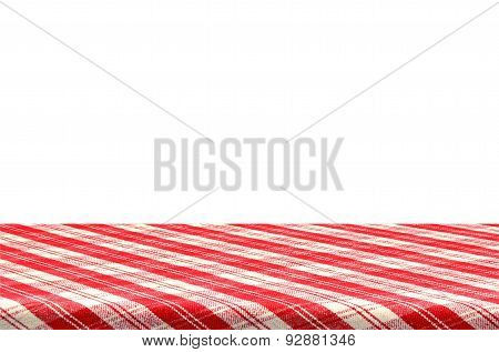 Picnic table with tablecloth.