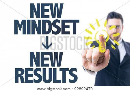 Business man pointing the text: New Mindset New Results