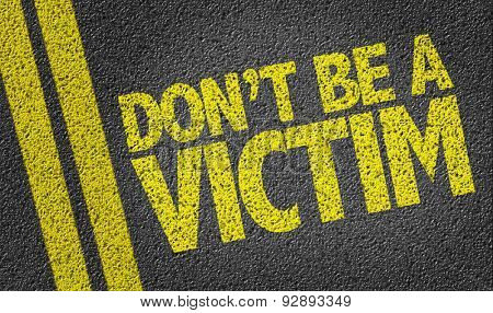 Don't be a Victim written on the road