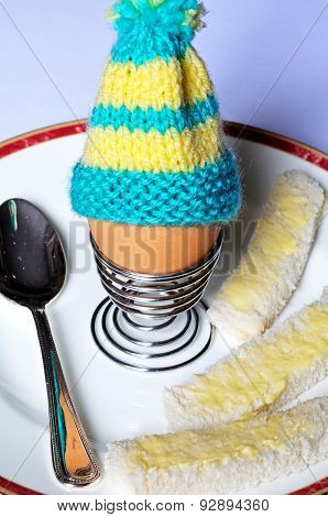 Boiled egg with bread soldiers.