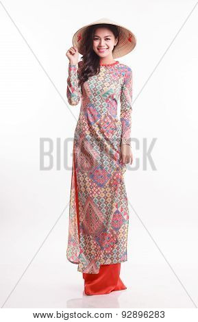 Beautiful Vietnamese Young Woman With Modern Style Ao Dai And Palm-leaf Conical Hat ( Non La ) On Wh