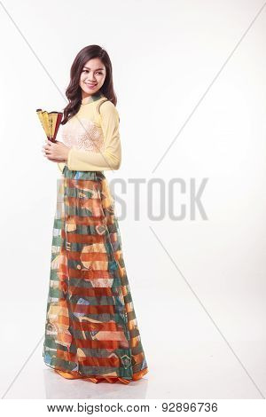 Beautiful Vietnamese Young Woman With Modern Style Ao Dai Holding A Paper Fan On White Background