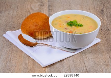 Fish chowder with bread.