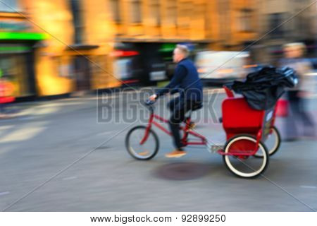 Trishaw Rides Quickly Along The Street Of The Old Town. Blurry