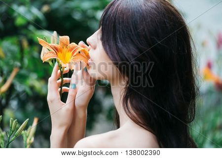 Woman Enjoys Orange Lily Flower