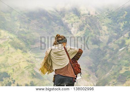 BANOS, ECUADOR, OCTOBER - 2015 - Young backpakers couple watching the view of mountains in Banos Ecuador South America