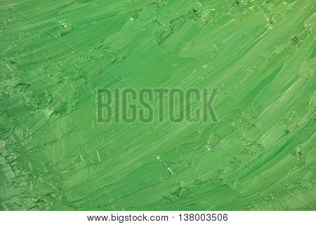 Green oil grungy painted background. Abstract oil painted background. Hand drawn green strokes. Ecology backdrop.