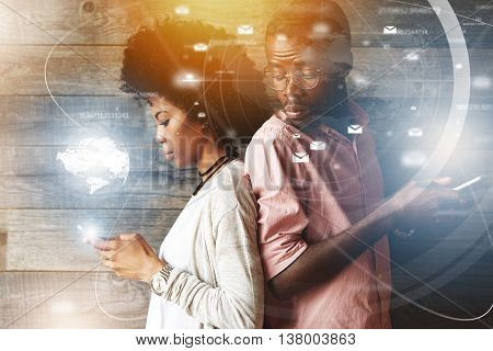 Double exposure of black girl texting her lover on cell phone while her jealous boyfriend suspect of her betrayal trying to read what she is typing looking over his shoulder with curious expression poster