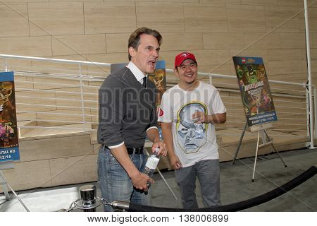 Jason Spisak and Eric Bauza joke around while at the premiere of