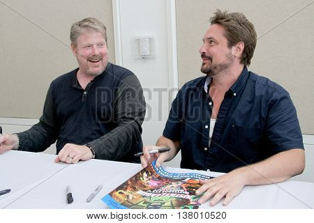 John DiMaggio and Will Friedle sign autographs at the