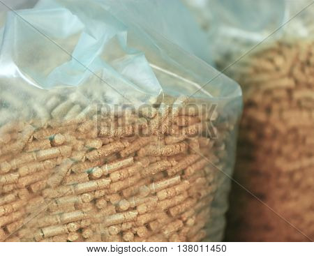 Cellophane bags with solid wooden pellets, closeup