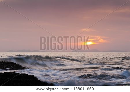 The landscape with sunset over the sea